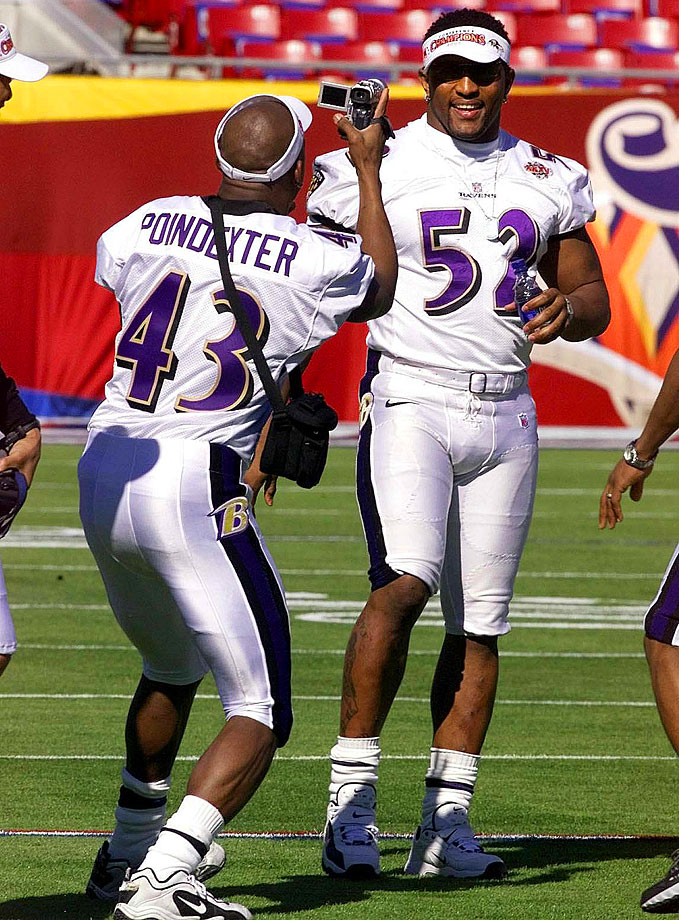 Ray Lewis is filmed by Ravens teammate Anthony Poindexter during Super Bowl XXXV Media Day in Tampa.