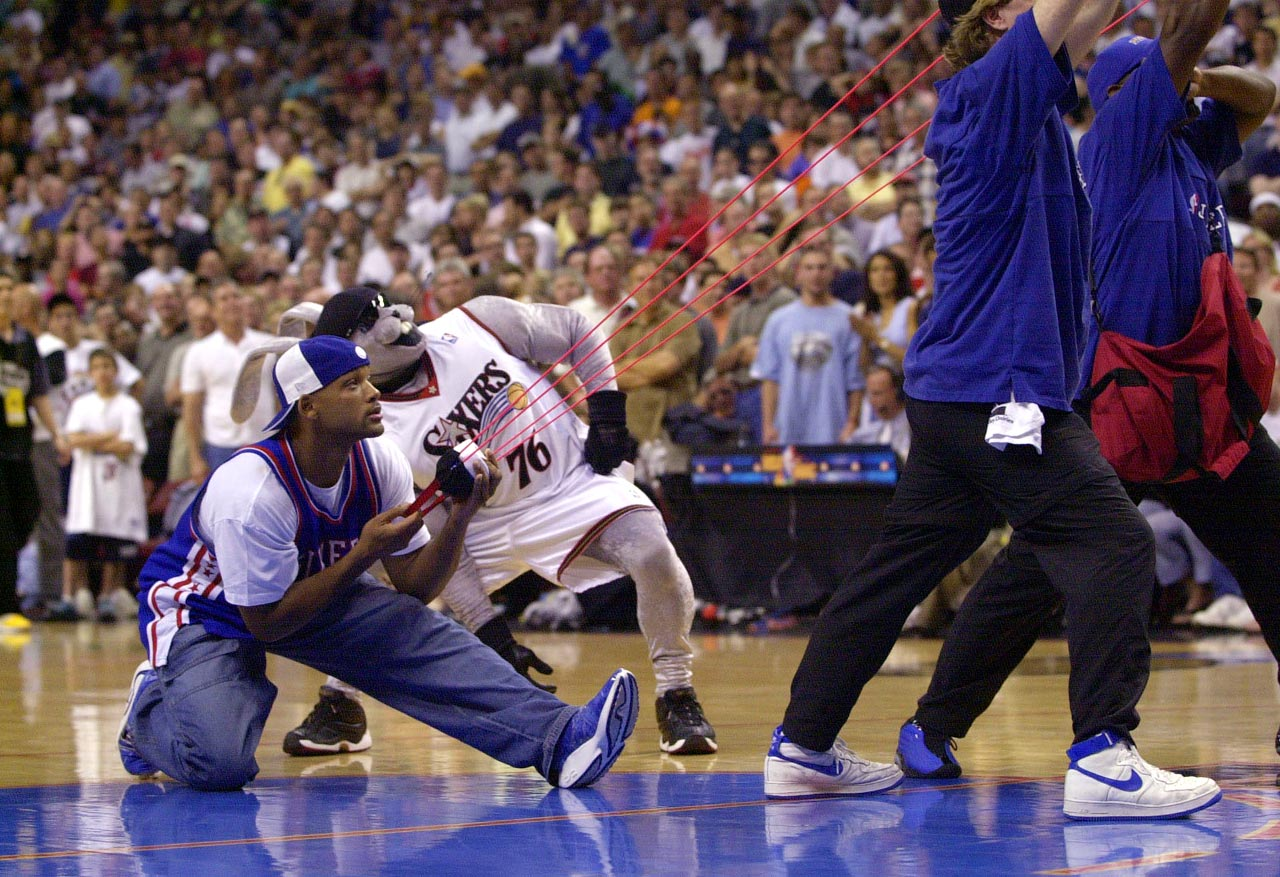 Will Smith pumps up the home crowd by slinging T-shirts into the stands during Game 3 of the 2001 NBA Finals.