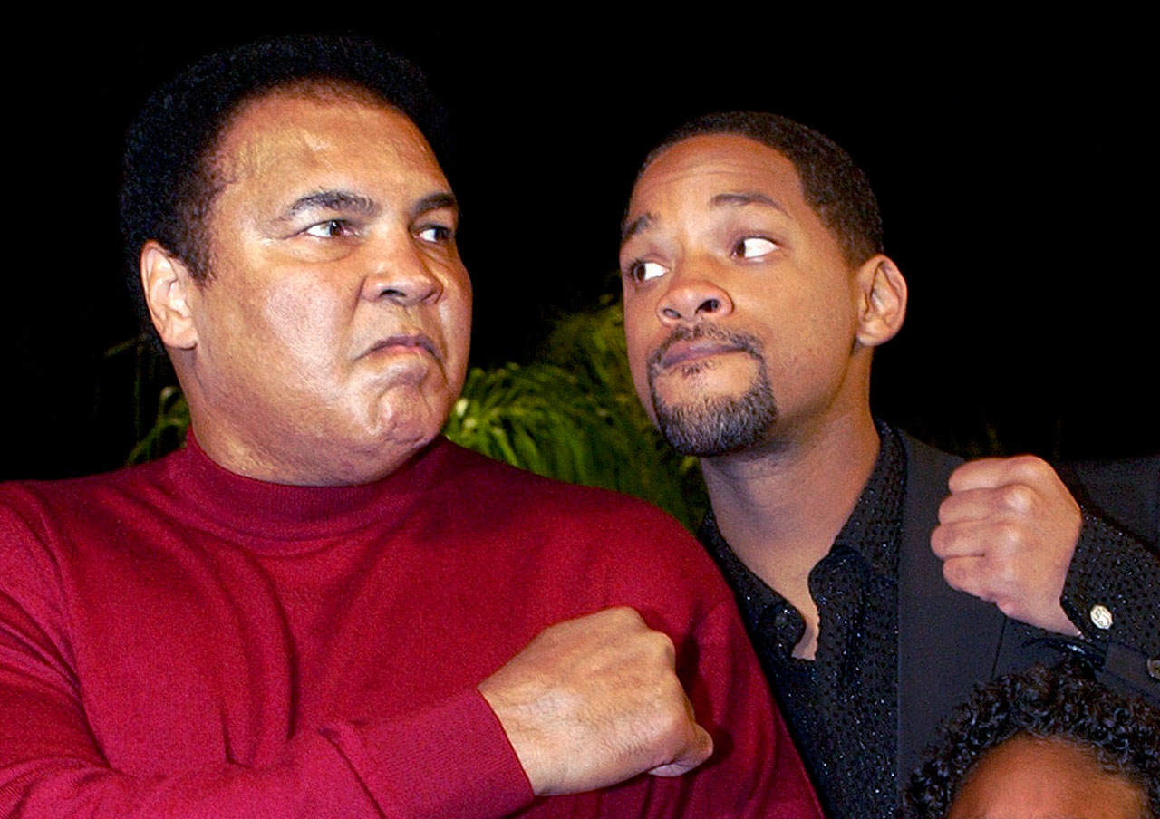 Muhammad Ali and Will Smith pose with poised fists during the premiere of ''Ali'' at Grauman's Chinese Theatre in Hollywood.