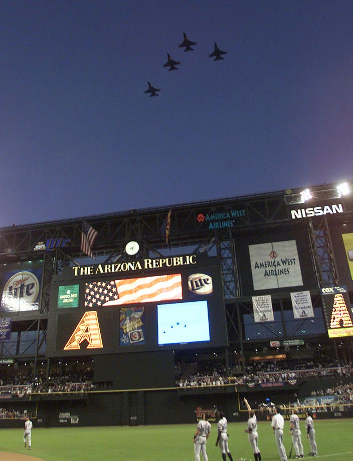 United States Air Force F-16's fly over Bank One Ballpark in Phoenix before Game 6 of the 2001 World Series between the Arizona Diamondbacks and the New York Yankees.