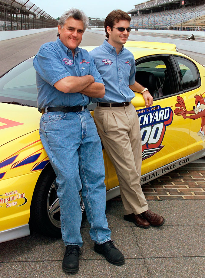 Jay Leno and Jeff Gordon talk during a break in a press event on the main straightaway at the Indianapolis Motor Speedway.  Leno, who is driving the Brickyard 400 pace car for the second time, was getting driving tips from Gordon.