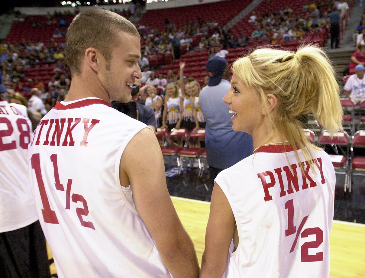 Justin Timberlake and Britney Spears smile during the 3rd annual Challenge for the Children basketball charity event in Las Vegas on July 29, 2001