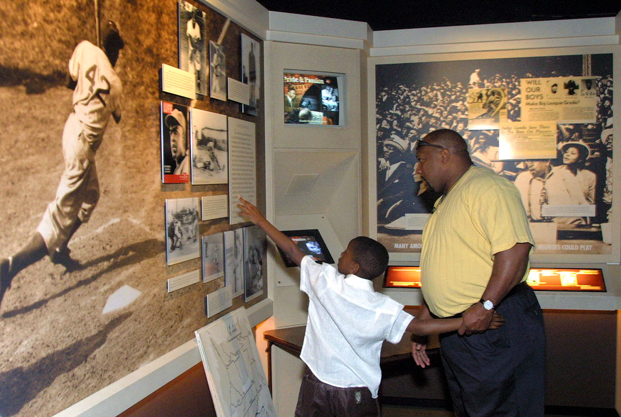 New Baseball Hall of Fame inductee Kirby Puckett and his son, Kirby, Jr., look at the Jackie Robinson exhibit as they tour the Baseball Hall of Fame in Cooperstown, N.Y., on May 3, 2001.