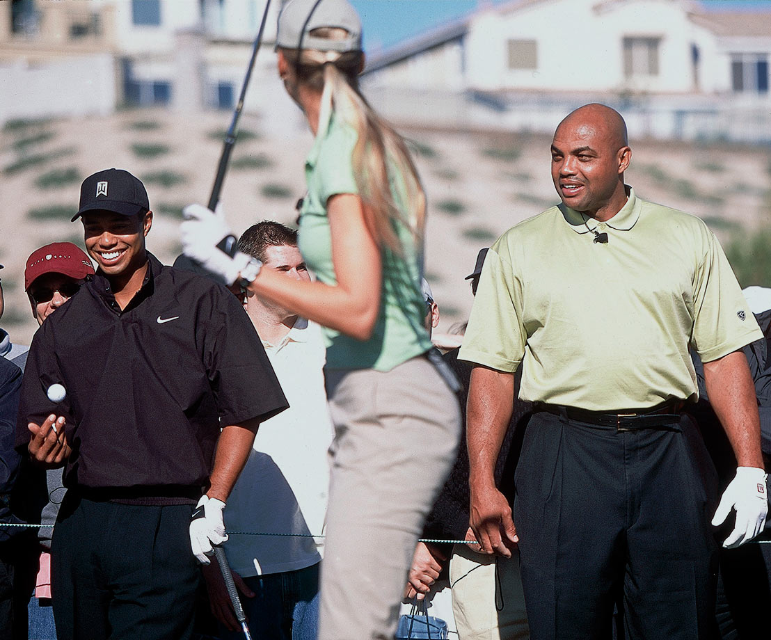 Charles Barkley jokes with Gabrielle Reese at Tiger Woods' foundation fundraiser Tiger Jam V at Rio Secco Golf Club in Henderson, Nev.