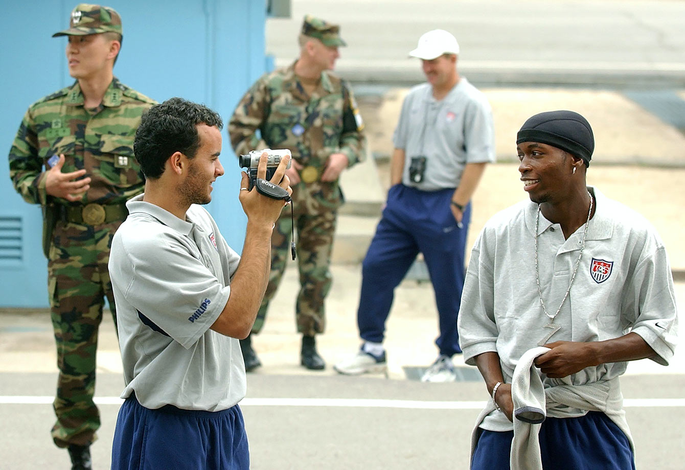 Landon Donovan records teammate DaMarcus Beasley during the national team's visit to the demilitarized zone. The U.S. soccer squad faced Portugal, South Korea and Poland in the first round of the 2002 FIFA Korea-Japan World Cup.