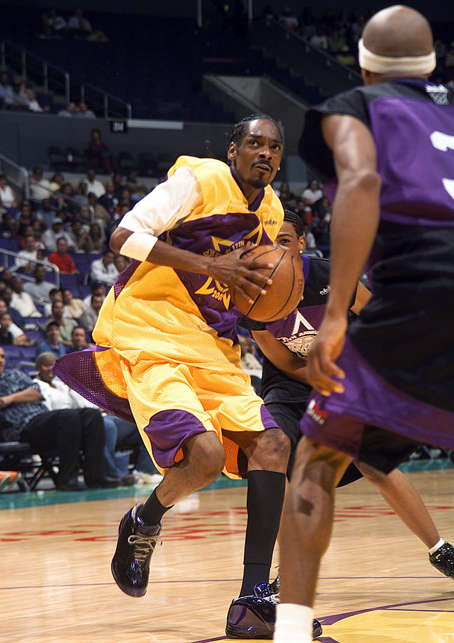 Snoop Dogg takes the ball to the hoop during the Celebrity portion of A Midsummer Night's Magic on Aug. 11, 2002 at Staples Center in Los Angeles.