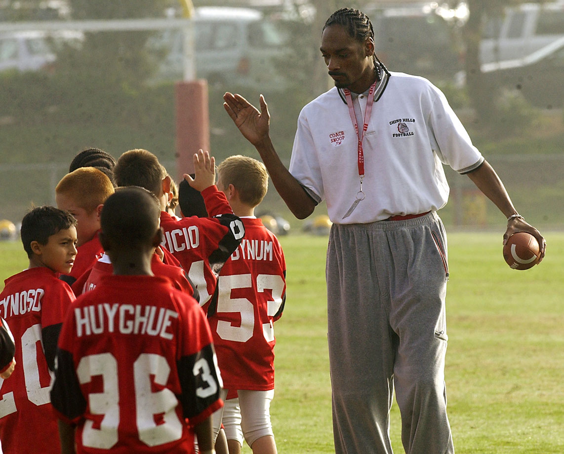 Snoop Dogg coaches the Chino Hills Pop Warner Football team on Nov. 24, 2002 in Lake Elsinore, Calif.