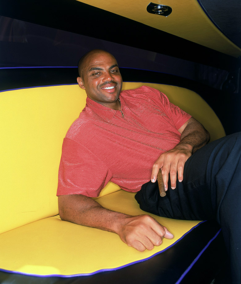 Charles Barkley relaxes in a limo for a portrait.