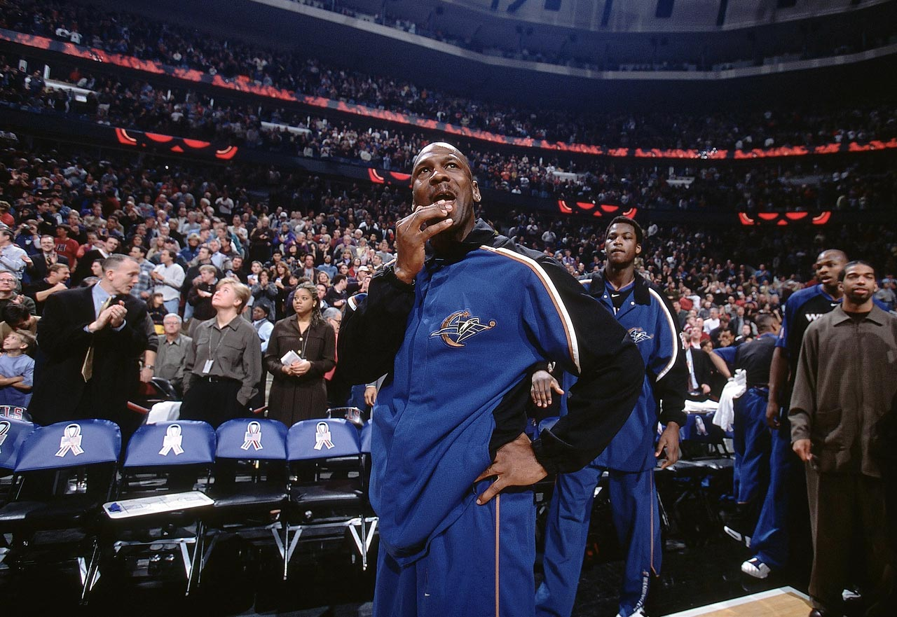 Michael Jordan appears emotional in his first game back in Chicago before his Washington Wizards took on the Bulls on Jan. 19, 2002. Jordan posted 16 points with 12 rebounds, two steals and two blocks, in the Wizards 77-69 win.
