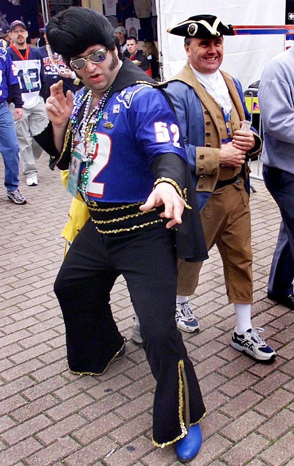 A New England Patriots and Elvis fan strikes a pose before Super Bowl XXXVI at the Superdome in New Orleans on Feb. 3, 2002.
