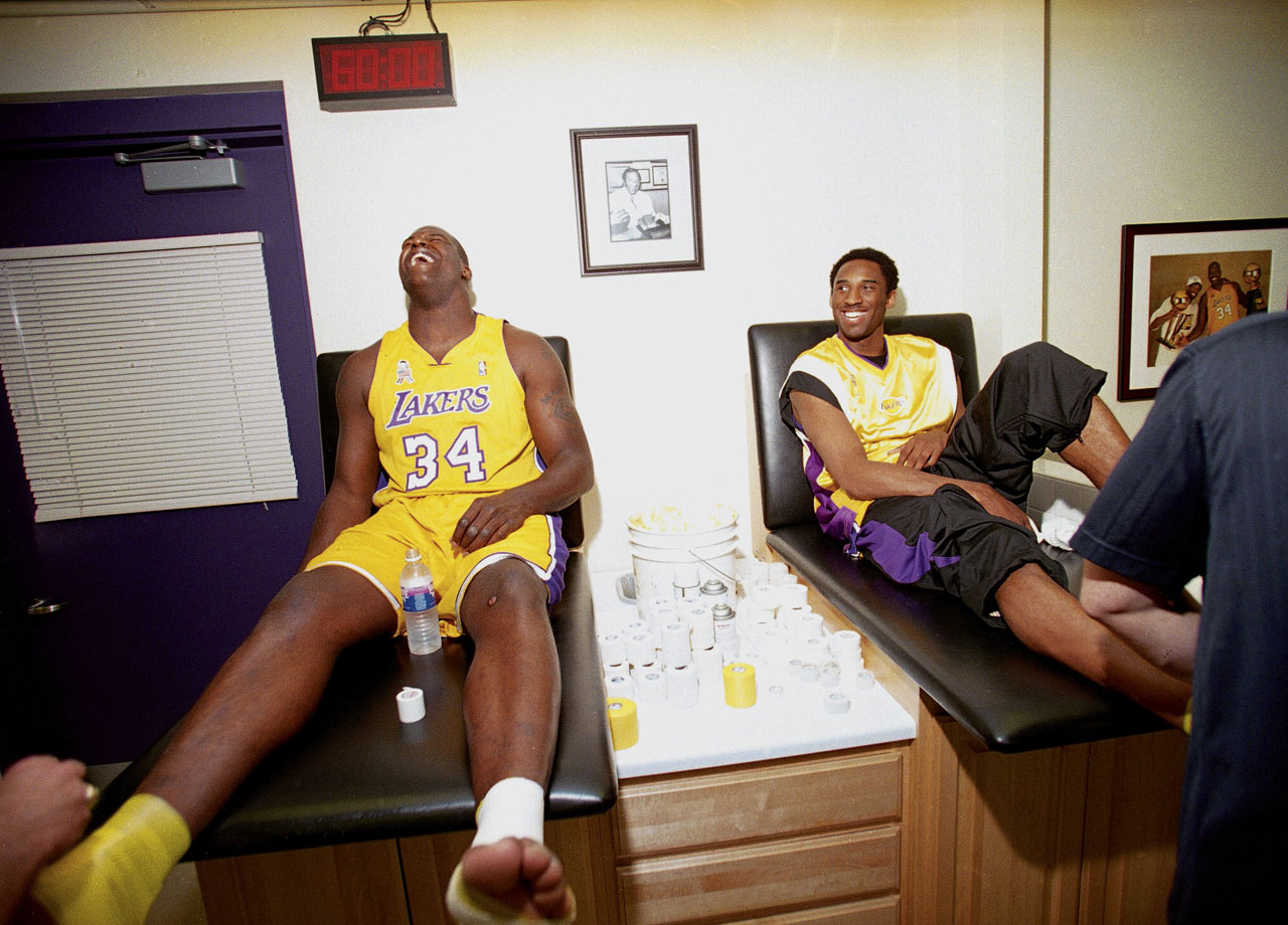 Shaq and Kobe laugh as the Big Cactus appears to have ticklish feet in the training room before a game in 2002.