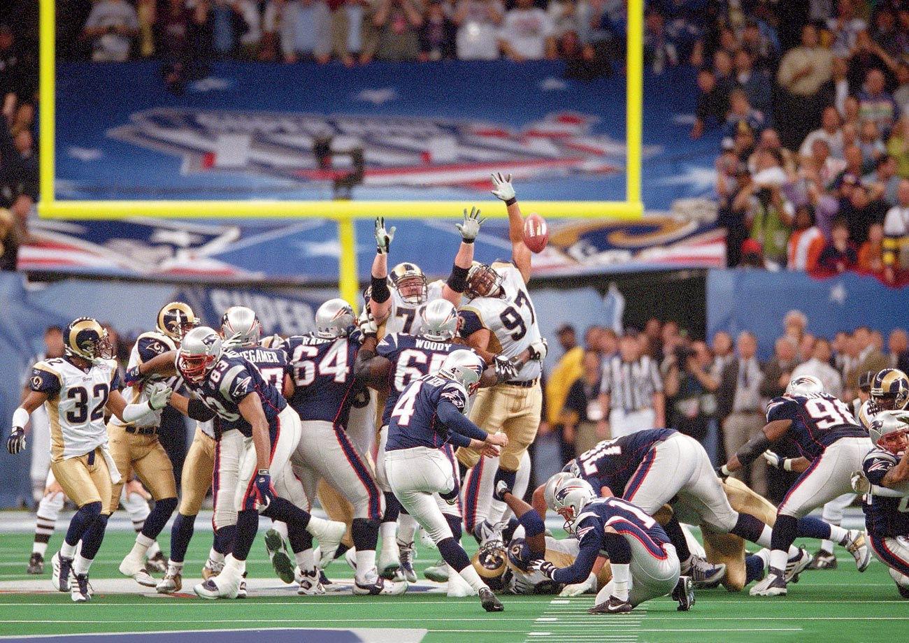 Adam Vinatieri kicks the game-winning field goal from 48 yards out to lift the Patriots over the Rams in the first Super Bowl played in a February.