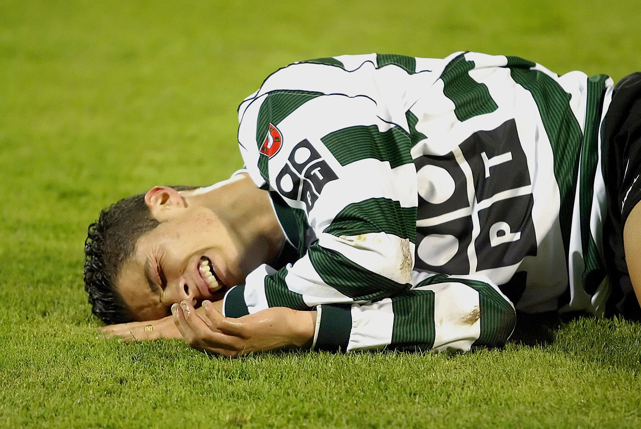 Cristiano Ronaldo lies injured while playing for Sporting Lisbon before his transfer to the English Premiership team Manchester United.
