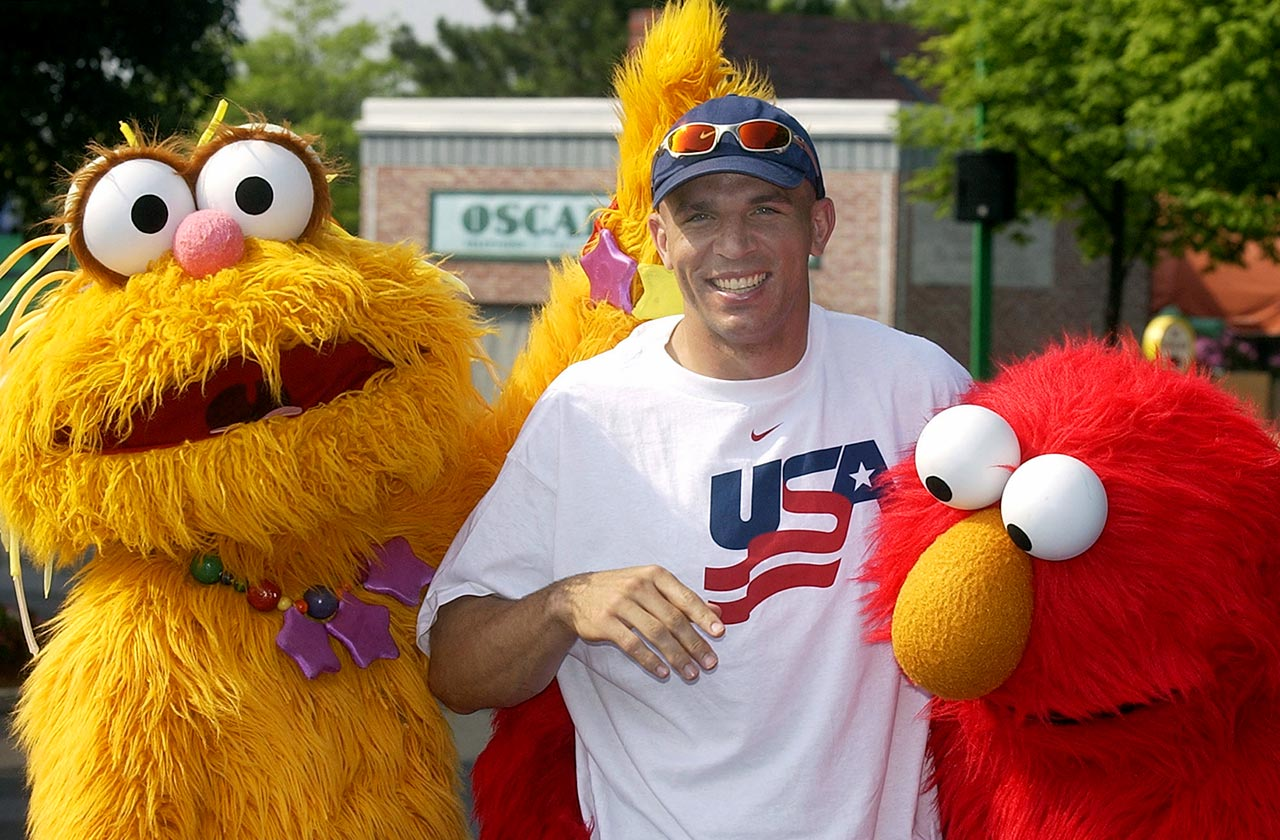 Jason Kidd is sandwiched between Sesame Street characters Zoe and Elmo during a visit to Sesame Place theme park in Langhorne, Pa.