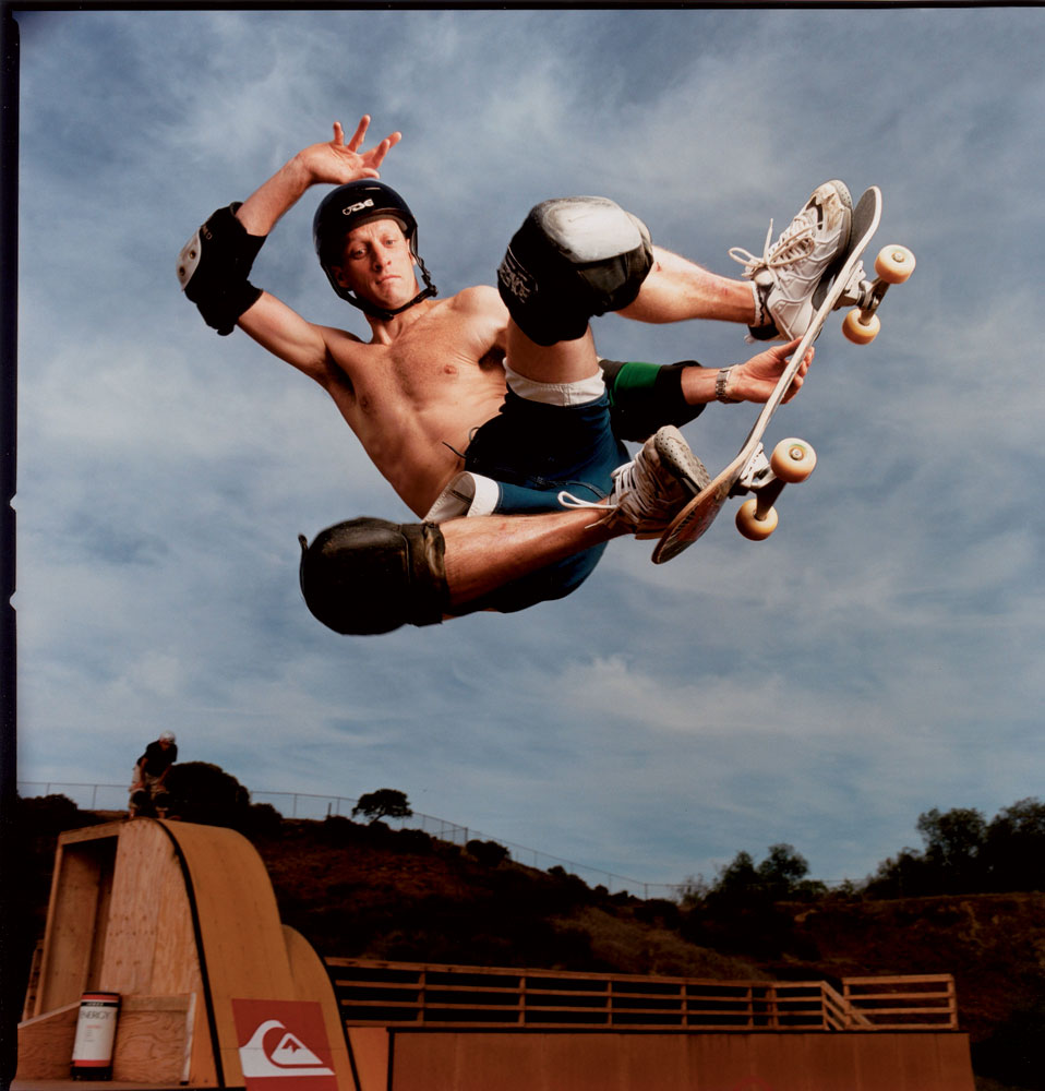 In an iconic Sports Illustrated portrait, Tony Hawk hangs in the air while performing one of his signature tricks.