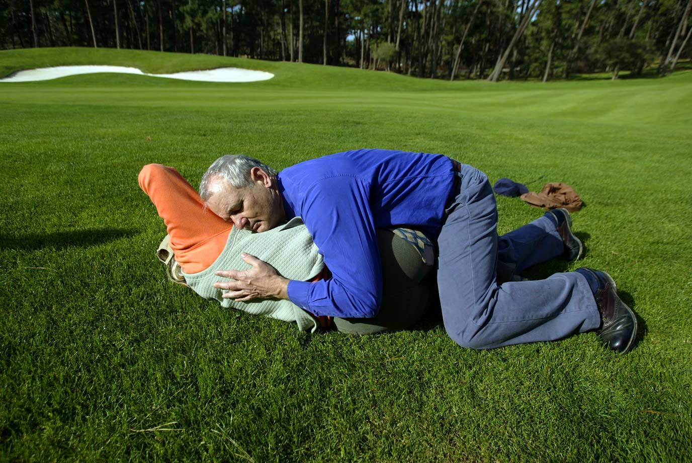 Bill Murray hugs Laura Davies to the ground during the AT&T Pebble Beach National Pro-Am golf tournament on Feb. 7, 2003 at Pebble Beach, Calif.