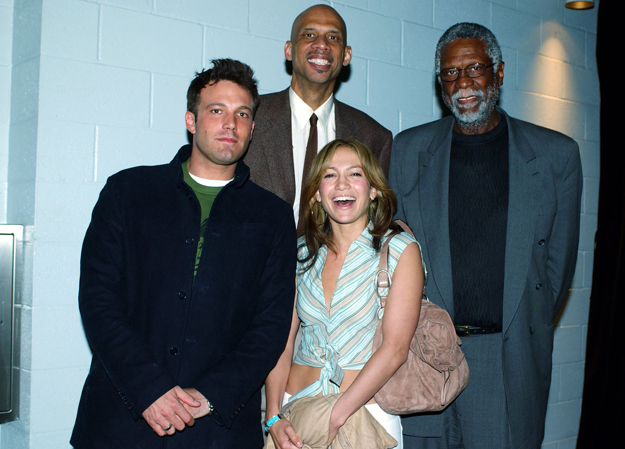 Ben Affleck and Jennifer Lopez pose with Kareem Abdul-Jabbar and Bill Russell as the Los Angeles Lakers host the San Antonio Spurs in Game Four of the Western Conference Semifinals on May 11, 2003 at Staples Center in Los Angeles.