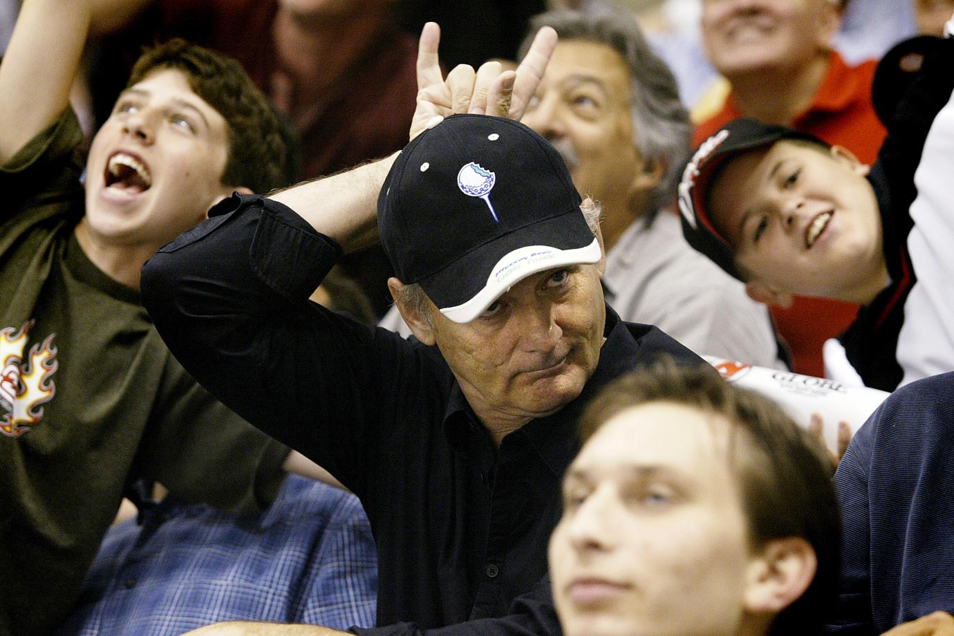 Bill Murray gives the Devils sign as he watches Game 7 of the 2003 Stanley Cup Final between the New Jersey Devils and the Mighty Ducks of Anaheim on June 9, 2003