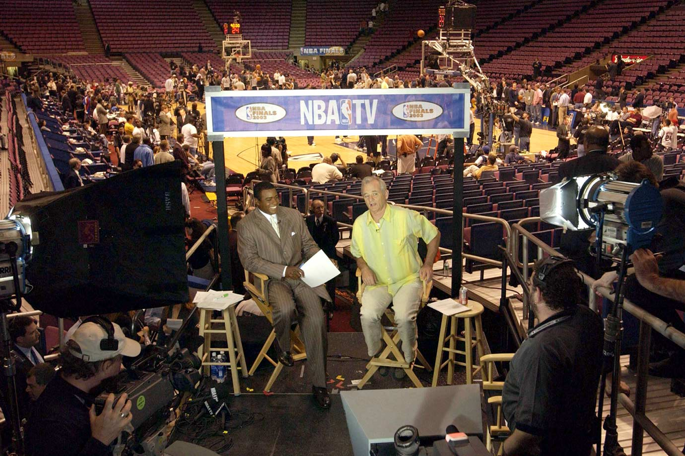 Bill Murray appears on NBA TV with Ahmad Rashad before Game 4 of the NBA Finals between the New Jersey Nets and the San Antonio Spurs on June 11, 2003 at Continental Airlines Arena in East Rutherford, N.J.