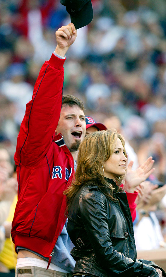 Ben Affleck and Jennifer Lopez cheer during player introductions prior to the start of Game 3 of the American League Championship Series between the Boston Red Sox and New York Yankees on Oct. 11, 2003 at Fenway Park in Boston.