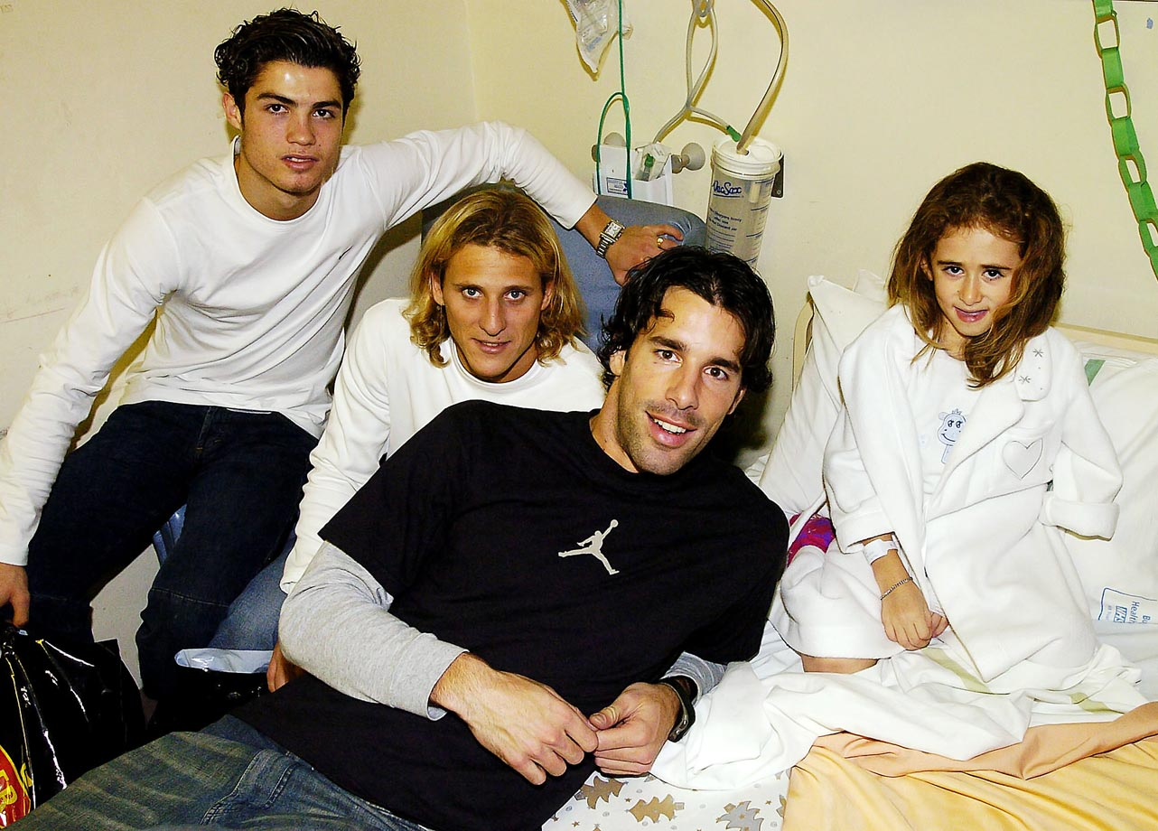Cristiano Ronaldo and Manchester United teammates Diego Forlan and Ruud van Nistelrooy pose with Casey Ogden during the players' annual visit to children's hospitals in Manchester.