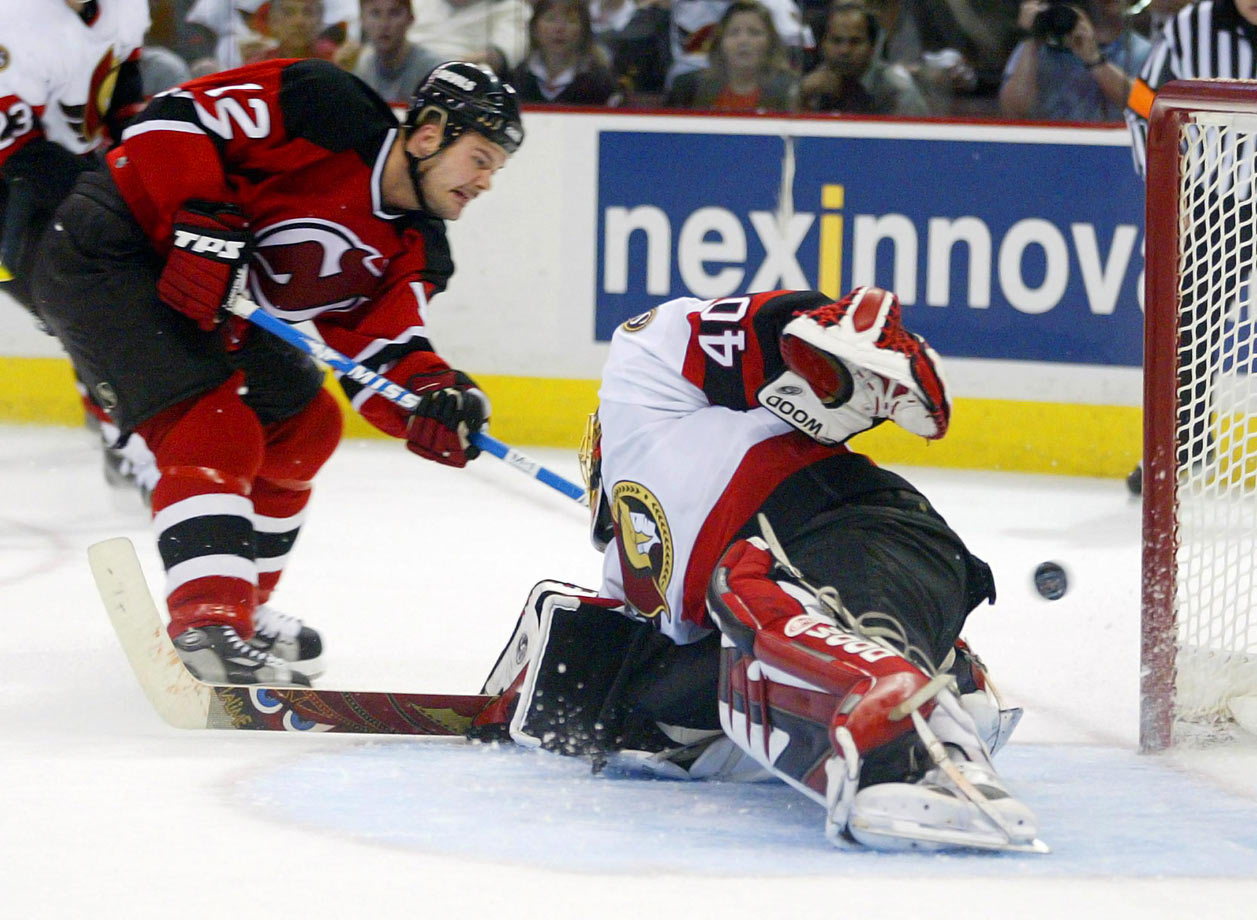 "After the Devils blew a three-games-to-one lead on the Presidents' Trophy-winners, winger Jeff Friesen had to redeem himself for a third-period turnover that allowed the Senators to tie the game at 2-2 in front of a roaring crowd in Ottawa. With 2:14 to play in regulation, Friesen scored the biggest goal of his career, beating goalie Patrick Lalime. ""I couldn't even react, I couldn't even describe what that was like,"" Friesen said. ""It just happened to work out that I got a chance to get that big goal."""