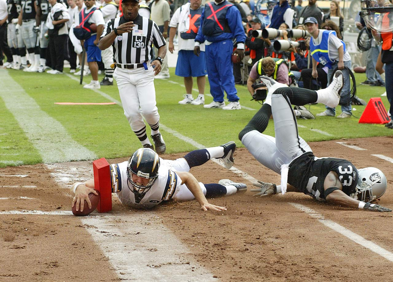 Drew Brees dives into the end zone for a 21-yard touchdown after receiving a pass from running back Ladainian Tomlinson while plaing the Oakland Raiders.