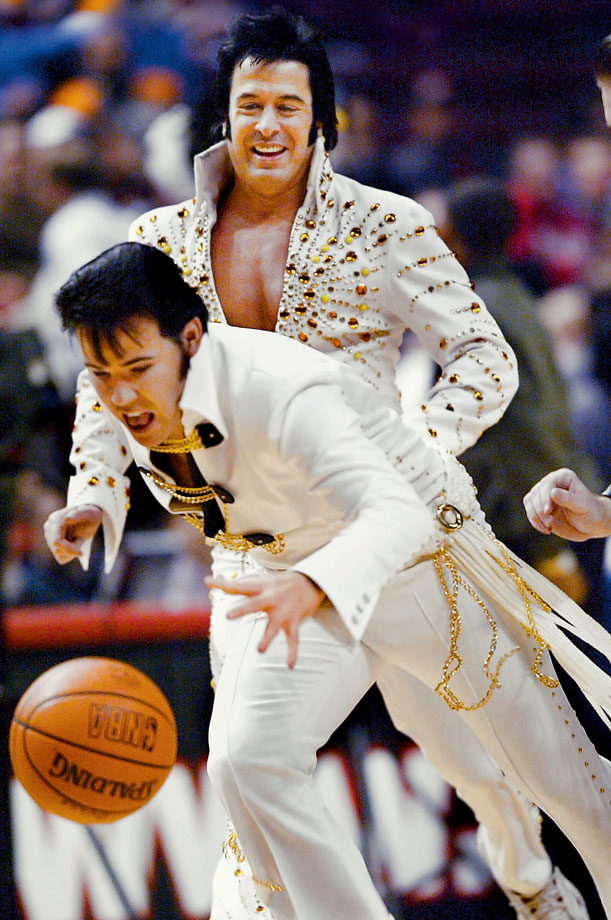 Elvis impersonators play basketball during halftime of a game between the Chicago Bulls and the Utah Jazz at the United Center in Chicago on Jan. 6, 2003.