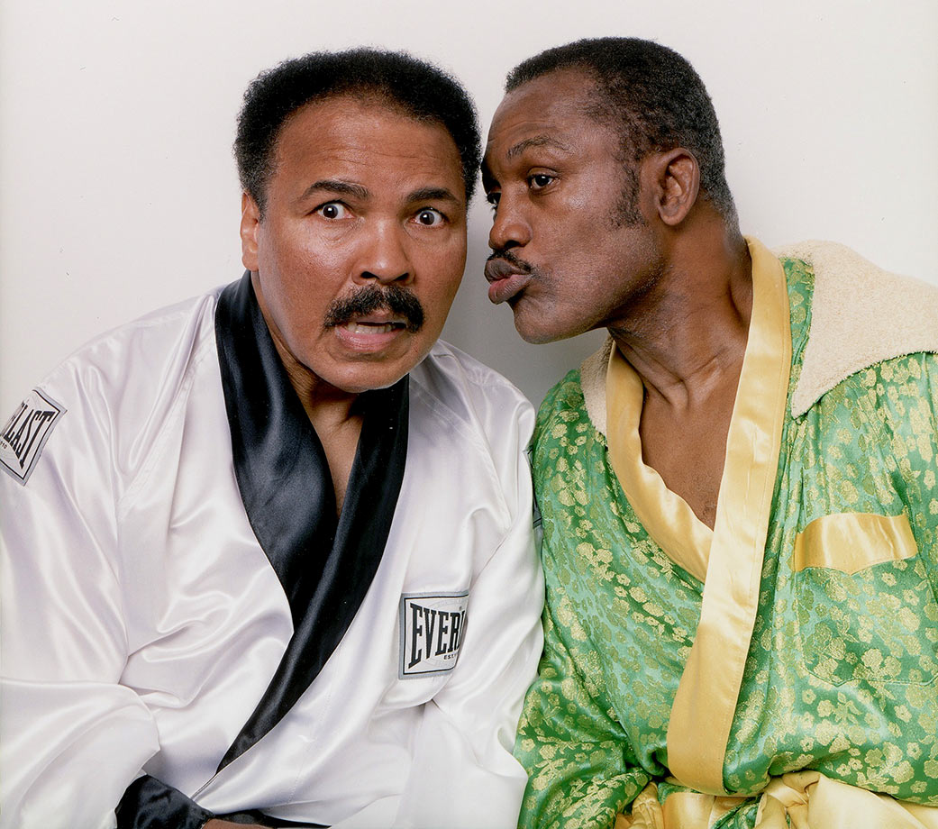 "Fierce rivals in the ring, Ali and Joe Frazier pose for a portrait in the boxing robes they wore the night of their first bout at Frazier's Gym in 2003. Ali said after Frazier's death in 2011 that he was ""a great champion."""