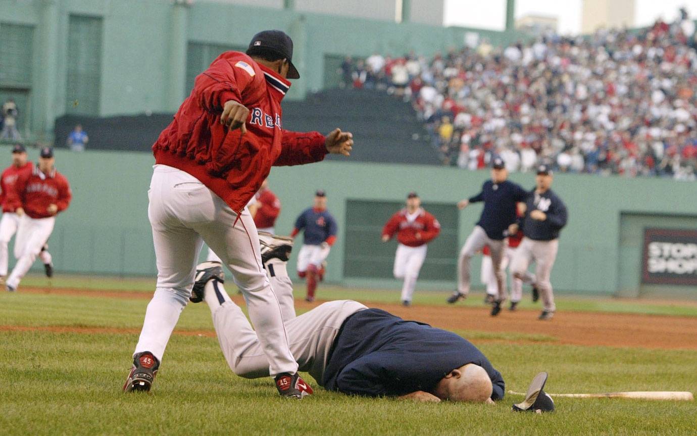 During a Pedro Martinez-Roger Clemens showdown in Game 3 of the ALCS, Yankees bench coach Don Zimmer, 73, lunged toward the Red Sox right hander and ending up with a faceful of Fenway sod. Later in the game New York reliever Jeff Nelson and right fielder Karim Garcia got into a fight with a Fenway Park groundskeeper after he cheered for Boston in the Yankees' bullpen.