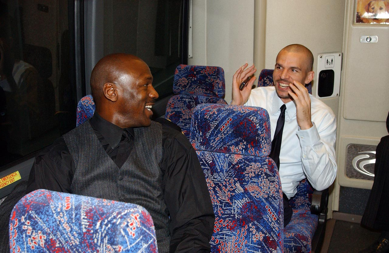 Michael Jordan and Jason Kidd share a laugh en route to the All-Star Game in Atlanta. Take note of the dog staring at them.