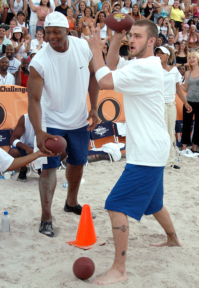 Eddie George amd Justin Timberlake compete during *NSYNC's Challenge for the Children V Celebrity Skills Challenge at Collins Park in Miami Beach, Fla., on July 29, 2003.