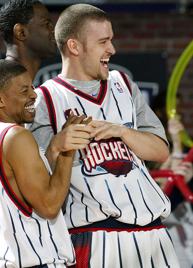Mugsy Bogues and Justin Timberlake share a laugh during the Celebrity Game at NBA Jam Session during NBA All-Star Weekend at the Georgia World Congress Center in Atlanta on Feb. 7, 2003.
