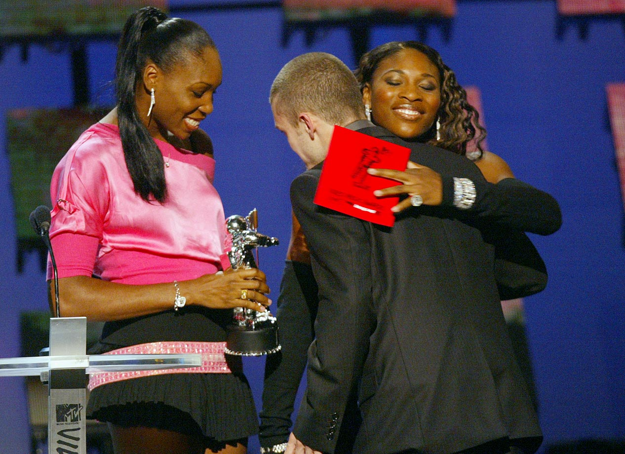 Venus and Serena Williams present the ''Best Male Video'' award to Justin Timberlake at the MTV Video Music Awards at Radio City Music Hall in New York City on Aug. 28, 2003.