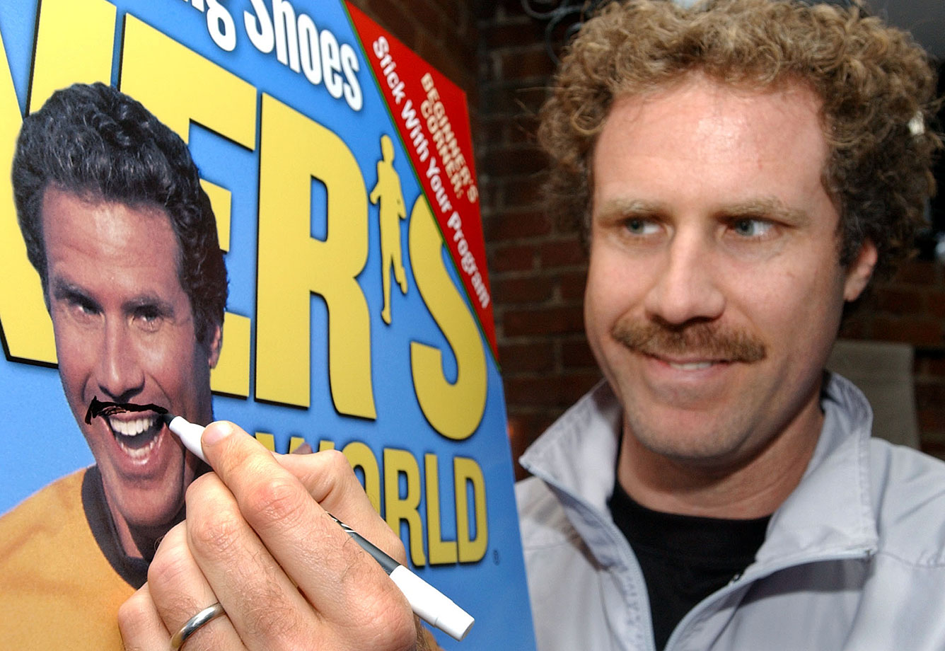 Will Ferrell makes an update to a blow-up of a recent Runner's World magazine cover featuring Ferrell during a news conference on April 20, 2003 in Boston.