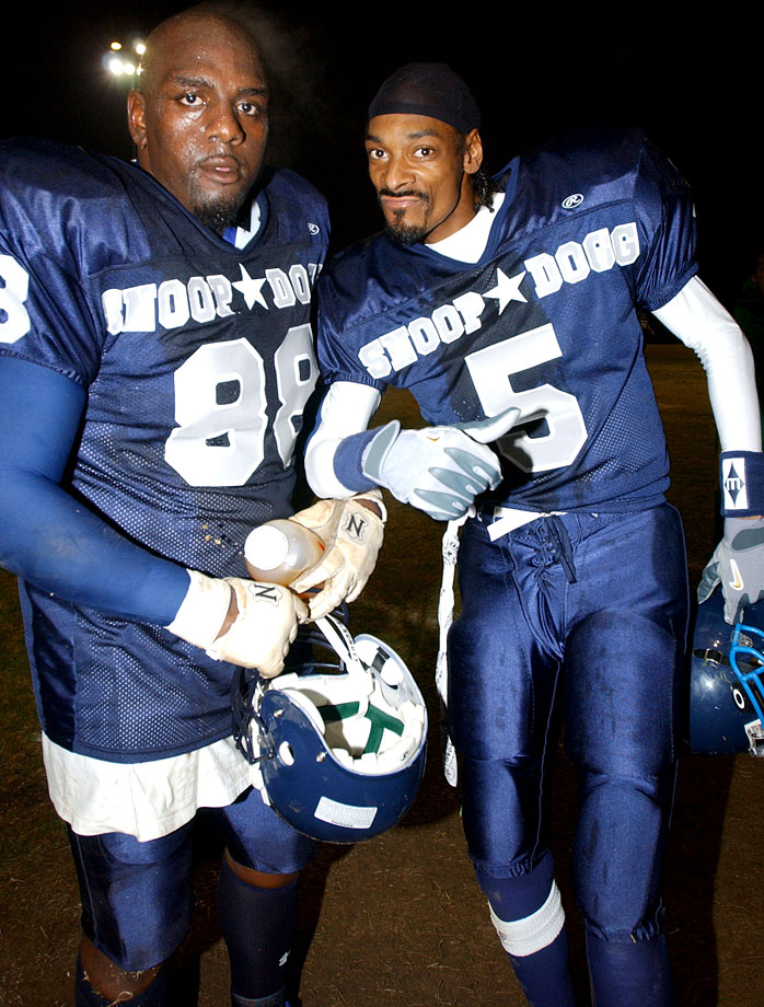Snoop Dogg poses with a teammate during Snoop's Classic 04' Game - Snoop Dogg All-Stars vs. LA Gunslingers on Jan. 17, 2004 at St. Matthias High School in Downey, Calif.
