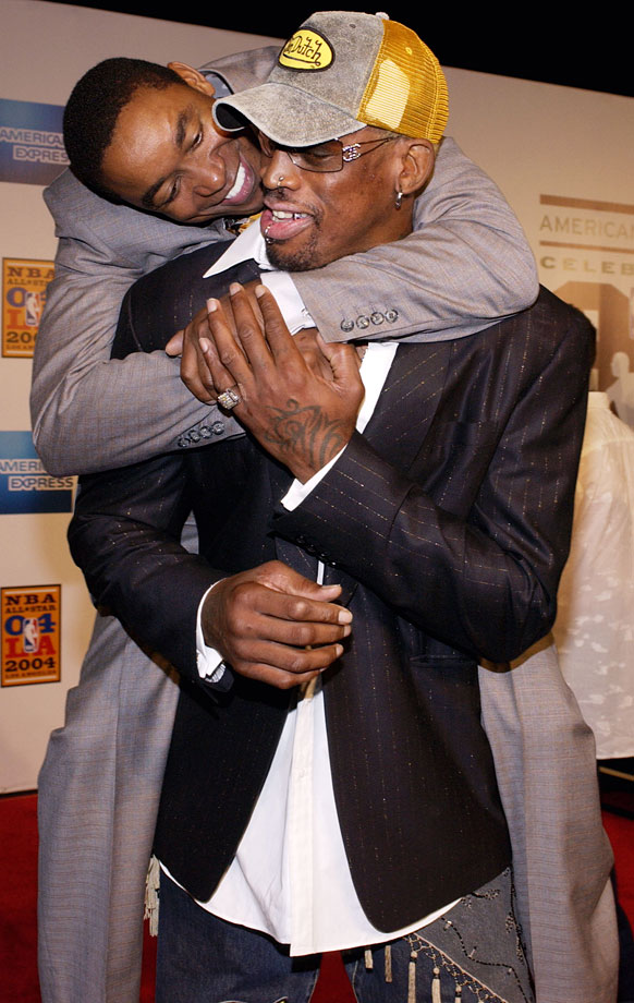 Former Pistons teammates, Rodman and Isiah Thomas, reunite at All-Star Weekend in 2004, where the two attended a special tribute to Magic Johnson.