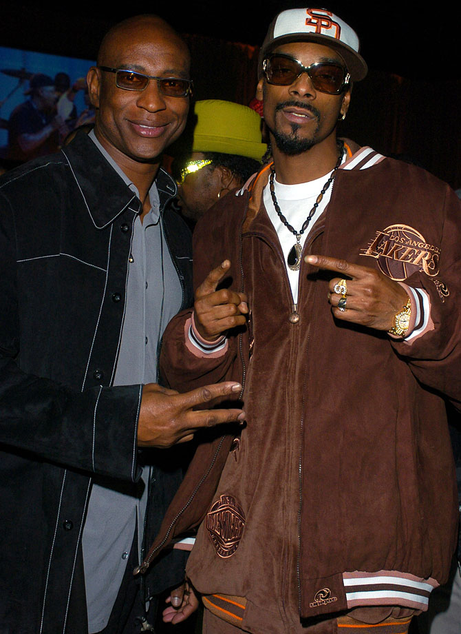 Eric Dickerson and Snoop Dogg pose together during General Motors & Shaquille O'Neal Present Rollin' 24 Deep GM-All Car Showdown on Feb. 12, 2004 at Raleigh Studios in Hollywood, Calif.
