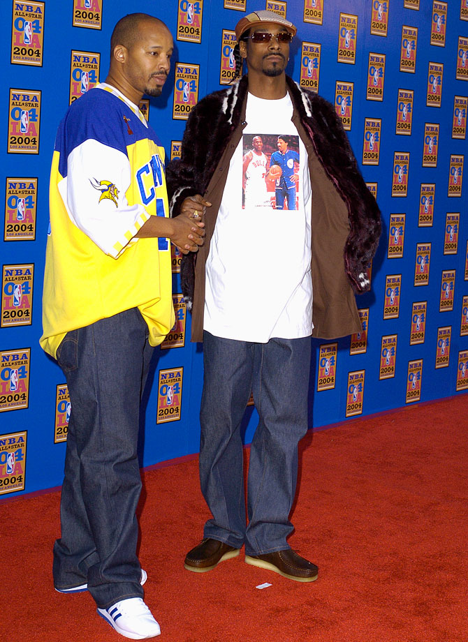Warren G and Snoop Dogg attend the NBA All-Star Game on Feb. 15, 2004 at Staples Center in Los Angeles.