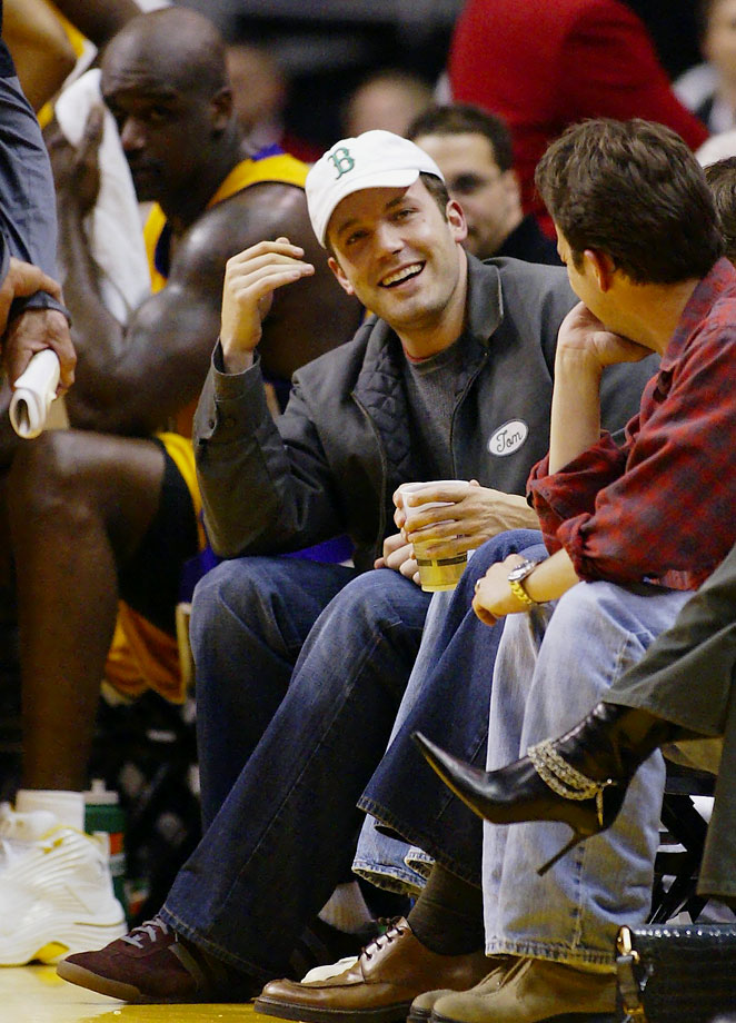 Ben Affleck smiles as Los Angeles Lakers center Shaquille O'Neal looks toward him during the Lakers' game against the Houston Rockets on April 1, 2004 at Staples Center in Los Angeles.