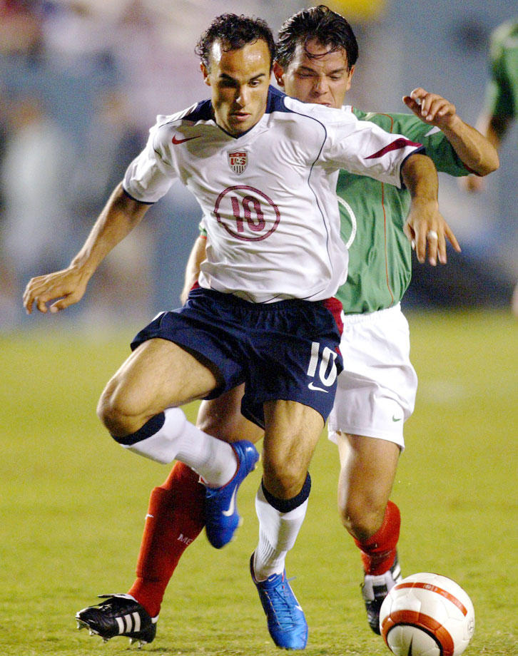 Landon Donovan moves the ball past Israel Lopez of Mexico during an International Friendly at the Cotton Bowl in Dallas. USA defeated Mexico 1-0.
