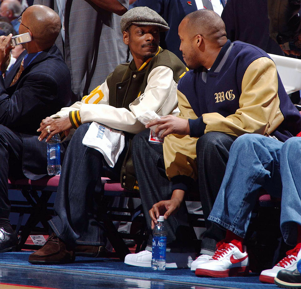 Snoop Dogg and Warren G attend Game Three of the Eastern Conference Semifinals between the New Jersey Nets and Detroit Pistons on May 9, 2004 at the Continental Airlines Arena in East Rutherford, N.J.