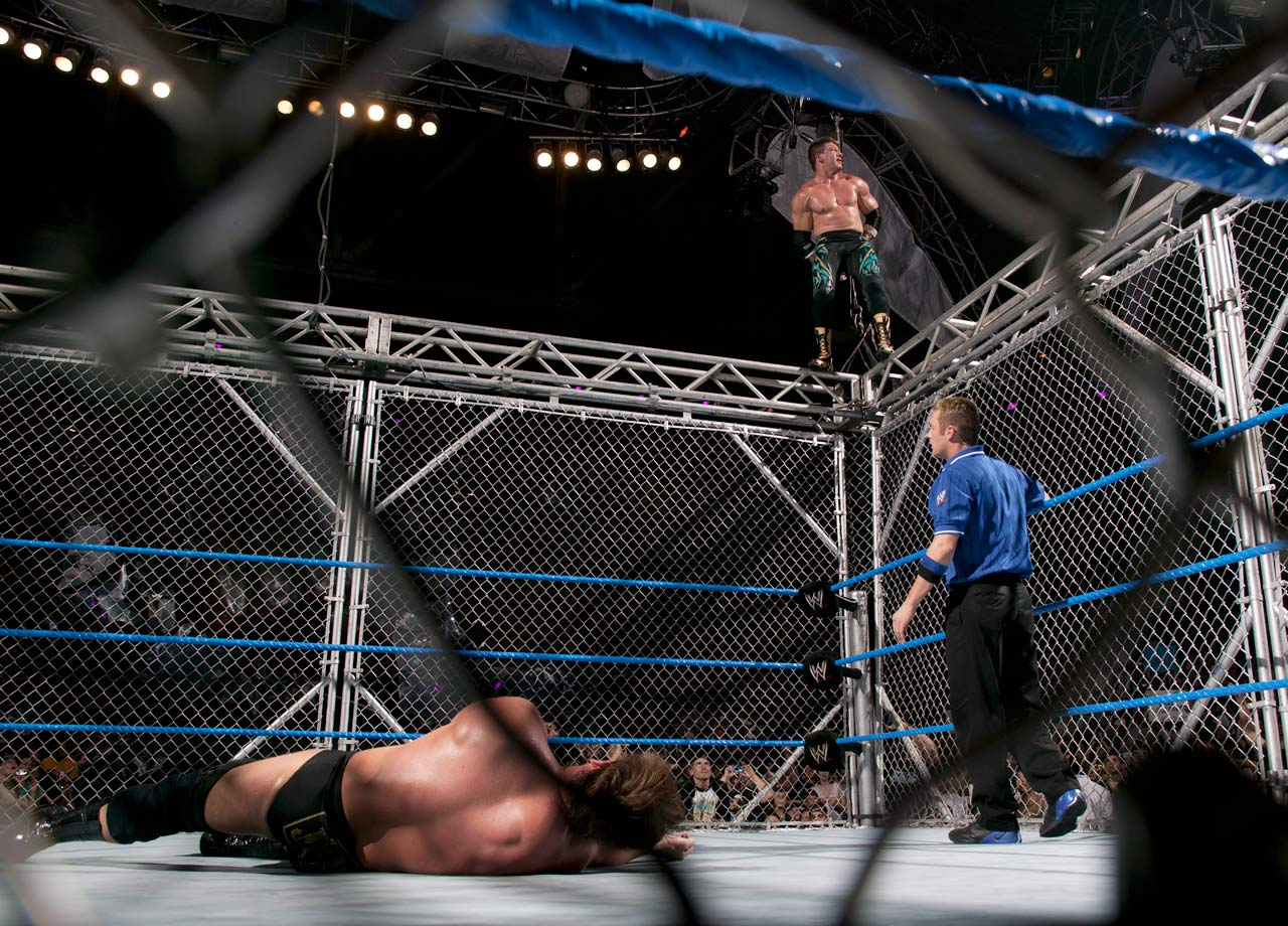 Eddie Guerrero and JBL create an instant classic inside a steel cage in a bout for the WWE Championship.  John Bradshaw Layfield won, escaping over the top, with the help of El Gran Luchador (Kurt Angle in disguise).