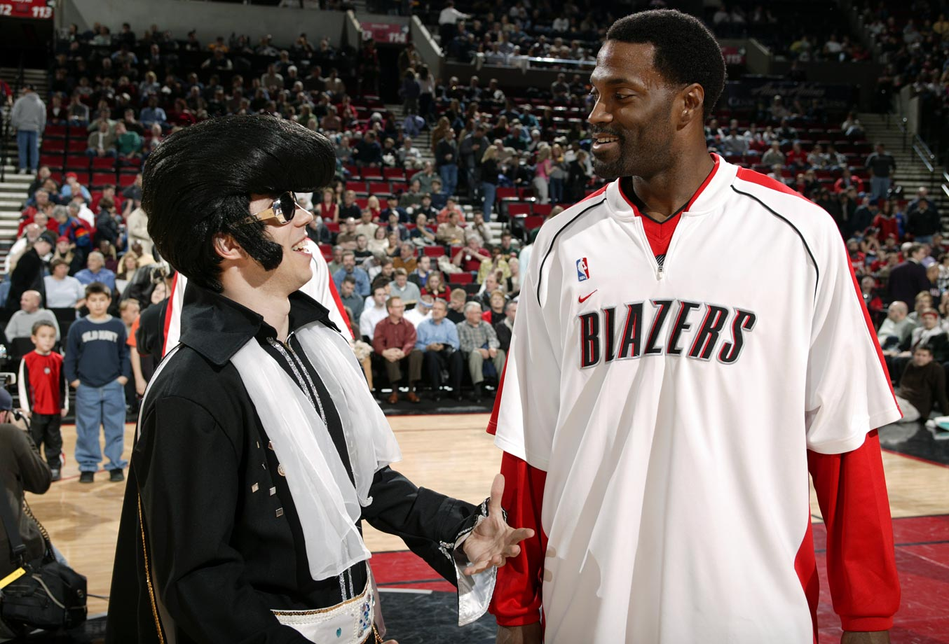 Dale Davis talks with an Elvis Presley impersonator prior to the Portland Trail Blazers game against the Memphis Grizzlies at Rose Garden in Portland on March 3, 2004.