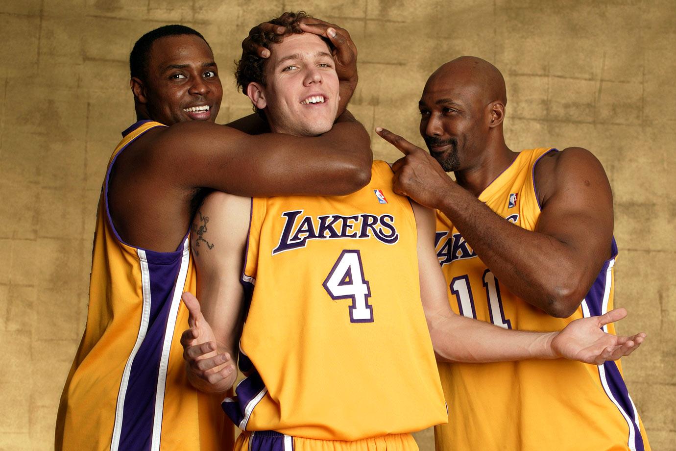 Karl Malone jokes around with teammates Luke Walton and Horace Grant during an SI photo shoot.