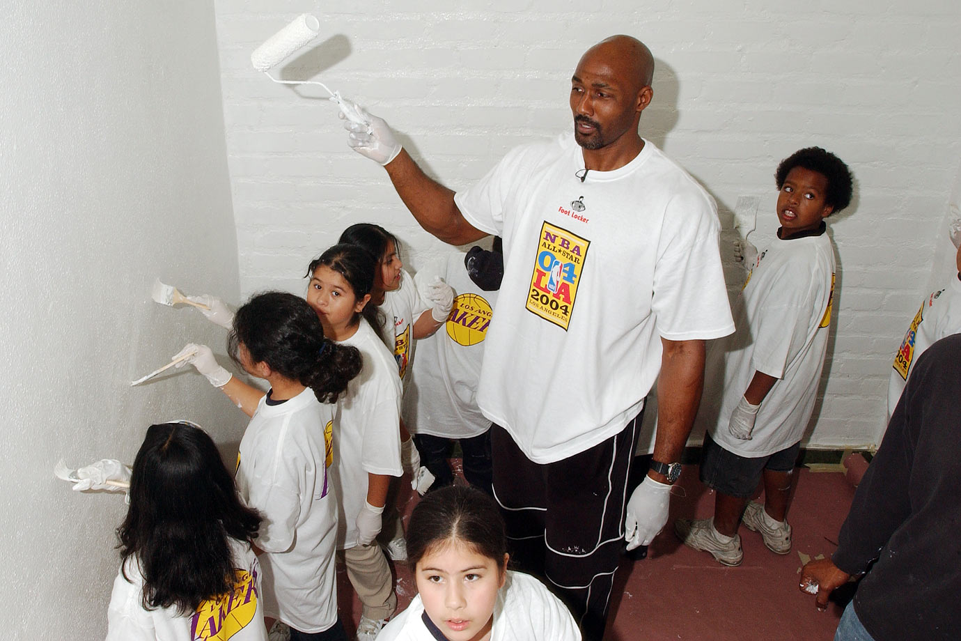 Karl Malone and some helpers renovate the Los Angeles Boys and Girls Club.