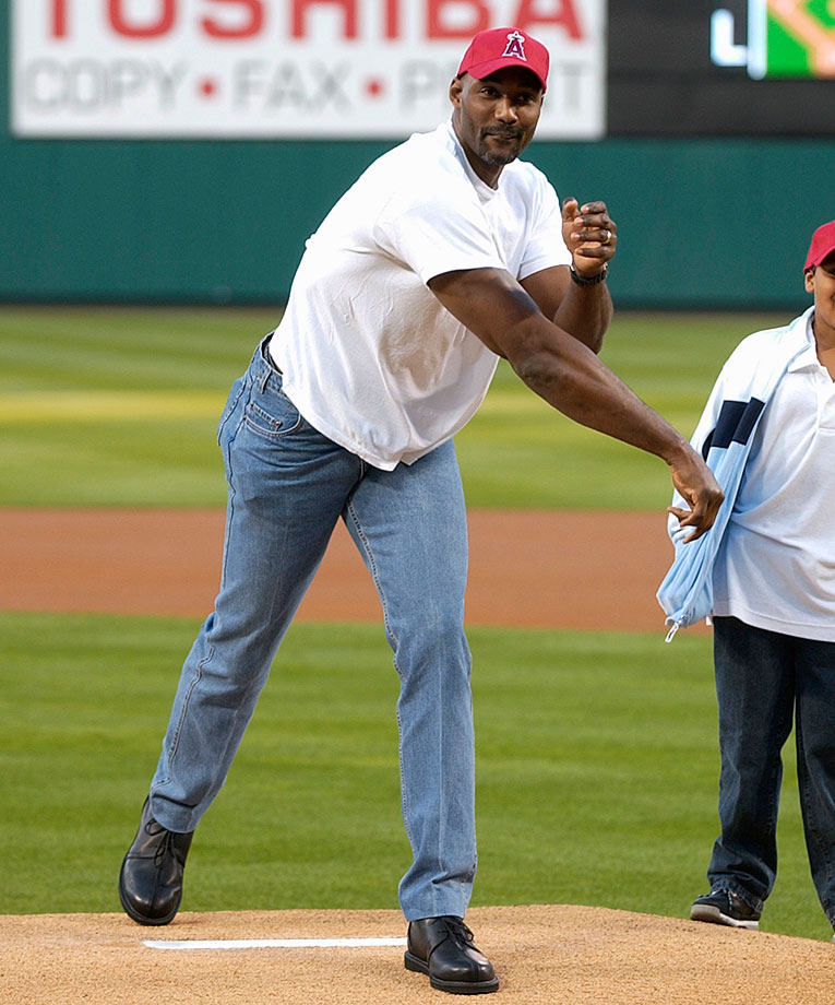 Karl Malone throws out the first pitch at an Angels-Rangers game in Anaheim, Calif.