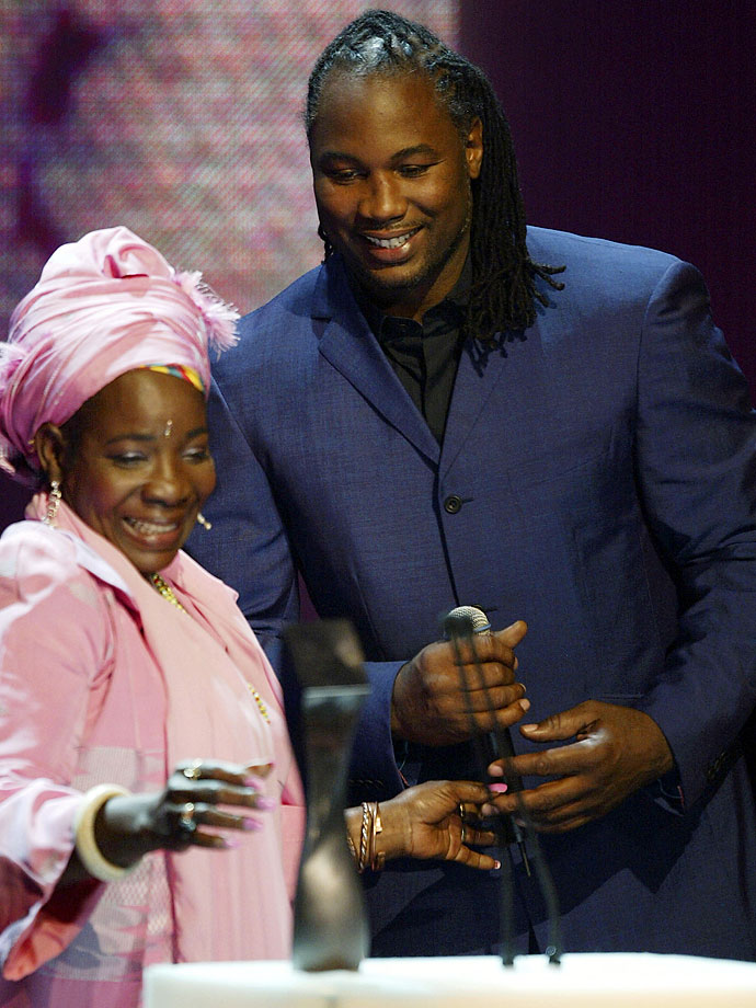 Boxer Lennox Lewis presents Bob Marley's widow Rita Marley an award for his Founding Member Induction at the UK Music Hall Of Fame in London on Nov. 11, 2004.