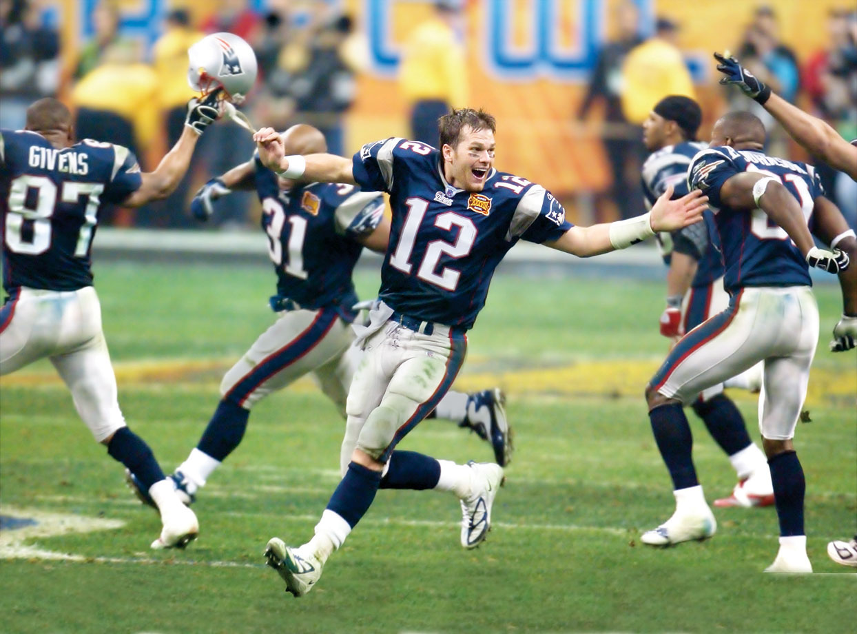 Quarterback Tom Brady and the New England Patriots rush the field after defeating the Carolina Panthers. Kicker Adam Vinatieri nailed a 41-yard field goal with four seconds remaining to put the Patriots on top 32-29.