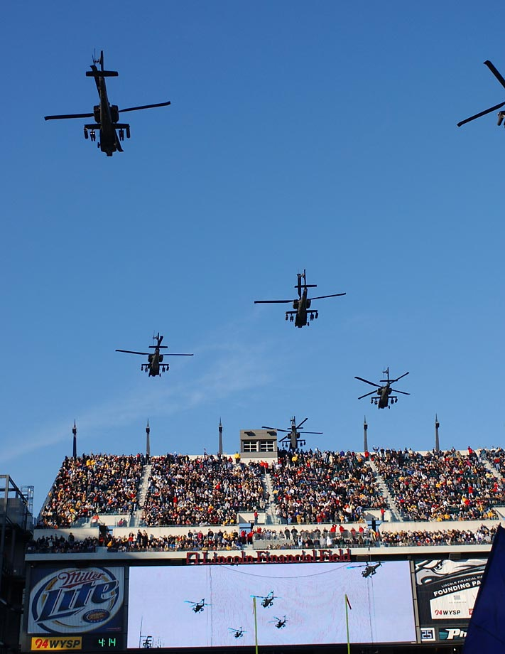 Apache helicopters and Blue Angles fly over during the annual Army-Navy game in December 2013.